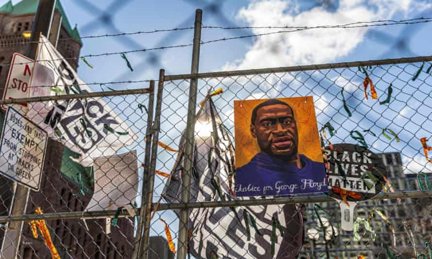 A poster with George Floyd's picture hangs from a security fence outside the Hennepin county government center on 31 March 2021 in Minneapolis, Minnesota.
