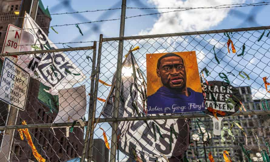 A painting of George Floyd is displayed with Black Lives Matter flags outside Hennepin county government centre in Minneapolis, Minnesota.