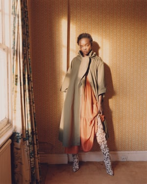 Trenchcoat, £380, and dress, £425, by Masscob. Boots, £2,395, by Christian Louboutin