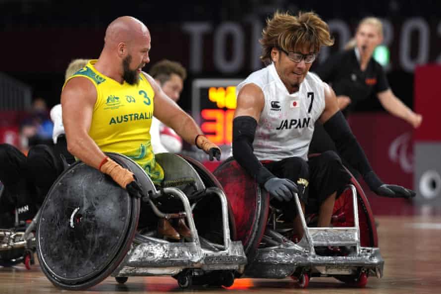 Japan's Daisuke Ikezaki, right, is chased by Australia's Ryley Batt.