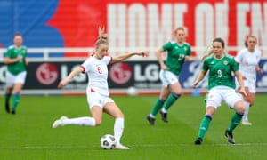 Leah Williamson of England passes the ball under pressure from Simone Magill of Northern Ireland.