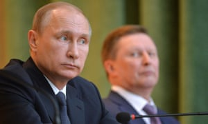 Vladimir Putin fired his chief of staff Sergei Ivanov (background), and replaced him with his deputy.