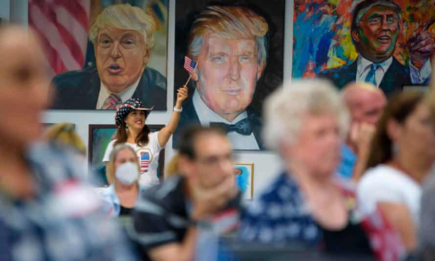 TOPSHOT-US-VOTE-DEBATE-POLITICS-ELECTION<br>TOPSHOT - A woman waves an American flag as President Trump supporters watch the presidential debate at the Trump Victory Campaign center in Katy, Texas on September 29, 2020. - Joe Biden and Donald Trump exchanged heated barbs attacking each other's competence and credibility, in a fiery first presidential debate 35 days ahead of the most tense US election in recent memory. (Photo by Mark Felix / AFP) (Photo by MARK FELIX/AFP /AFP via Getty Images)
