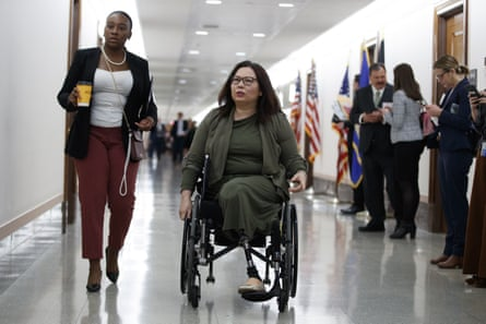 Senator Tammy Duckworth, R-Ill., arrives for a briefing on Capitol Hill in Washington, Thursday, March, 12, 2020, on the coronavirus outbreak.
