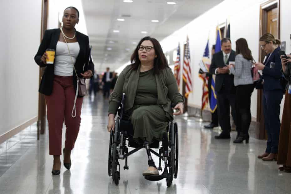 Senator Tammy Duckworth, R-Ill., arrives for a briefing on Capitol Hill in Washington, Thursday, March, 12, 2020, on the coronavirus outbreak.