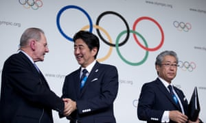 Japan's prime minister Shinzo Abe (centre) shakes hands with IOC president Jacques Rogge as Tokyo 2020 Olympic bid committee president Tsunekazu Takeda stands by after signing the host city contract for the 2020 Games.