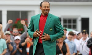 Tiger Woods is once again grinning in green.