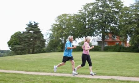 Older couple jogging together outdoors