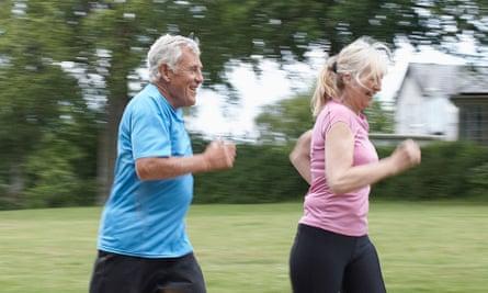 An older couple jogging