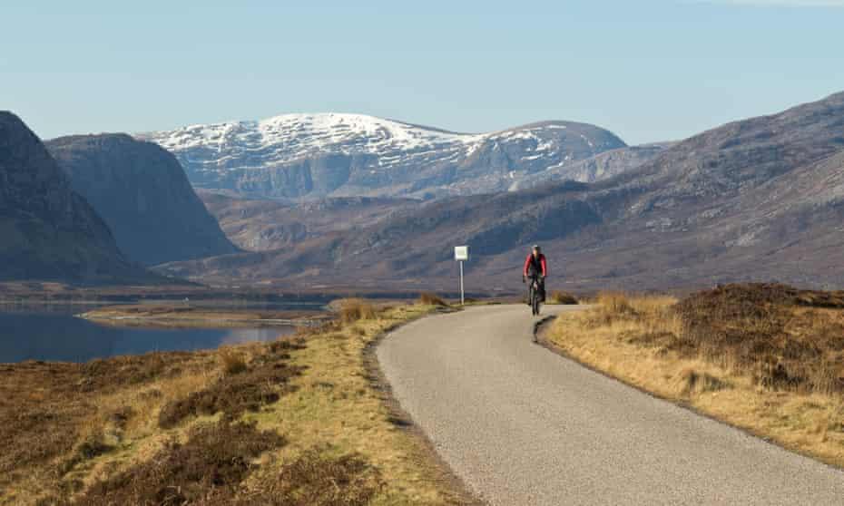 A cyclist on North Coast 500 along Loch Eriboll.