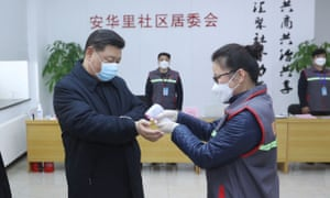 President Xi Jinping wears a facemask as a health official during an inspection of coronavirus prevention and control in Beijing.