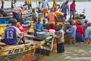 Early morning commerce on the shore of the fishing village of Nyanyano