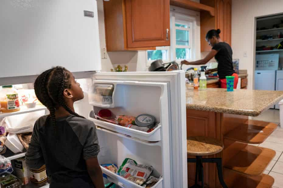 Cherokeena Robinson, 32, makes her son Mai'Kel Stephens, 6, lunch at their transitional house in San Pedro, California that they share with one or two other families at a time. Cherokeena lost her job during the pandemic and now relies on the organization Family Promise to help with housing, childcare, food, and counseling. Cherokeena and her son have been living in the transitional house since June 2020 where she pays $300 a month for rent for a private room until she can figure out her job and find a full private apartment of her own.