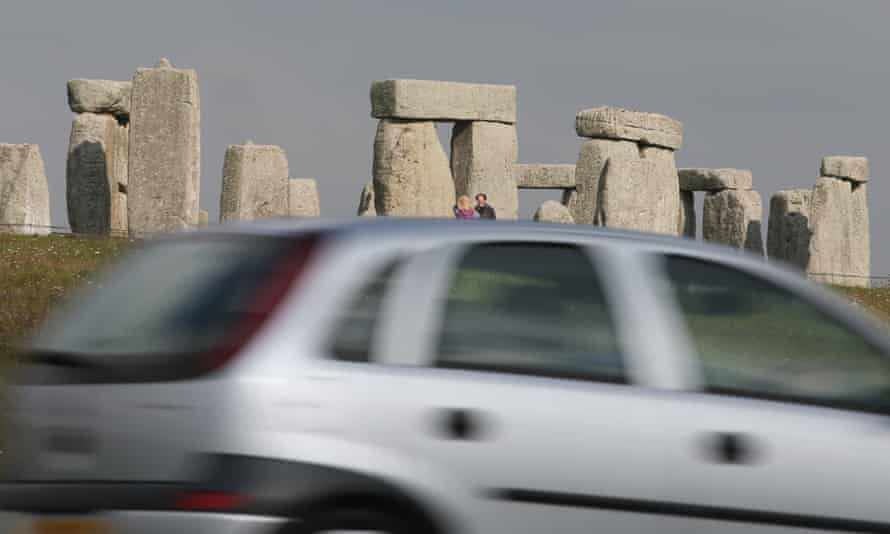 Traffic passing Stonehenge on the A303 road in Wiltshire.