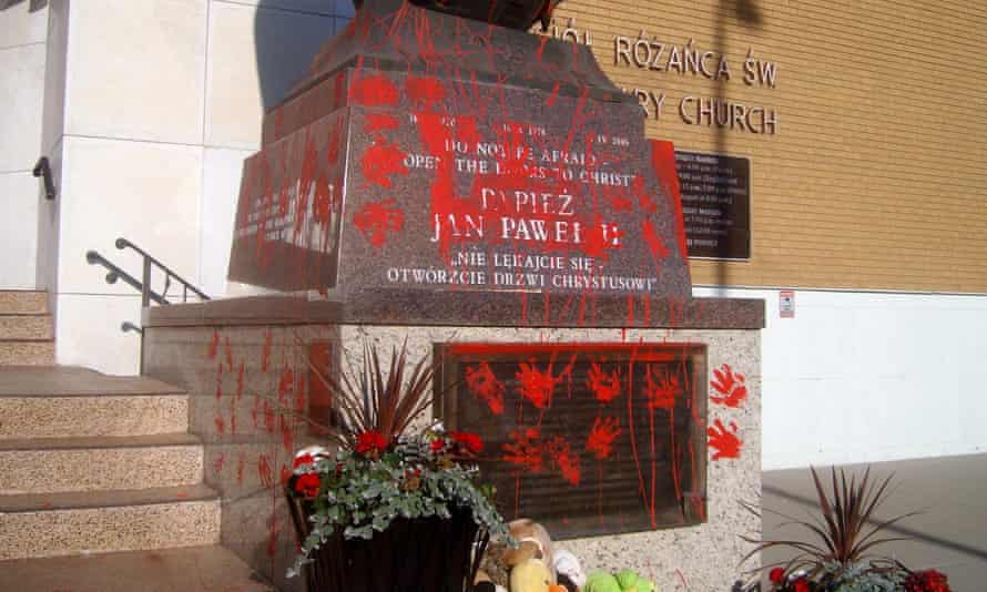 A statue of Pope John Paul II vandalized in Edmonton. Canada has been rocked by the discovery of nearly a thousand unmarked graves at the sites of church-run residential schools.