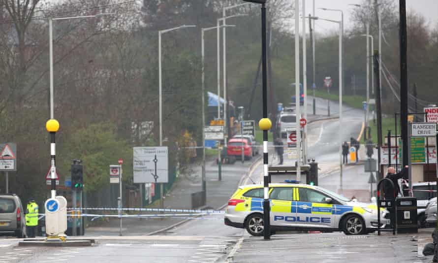 Police at the scene on Collier Row Road, Romford, where a man was shot dead by firearms officers.