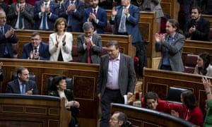 MPs show their support for Teruel Existe's Tomás Guitarte (centre) as he prepares to speak during the last day of the investiture debate.