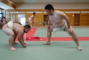 Kyuta Kumagai trains with his coach Shinichi Taira, a former professional sumo wrestler, at Komatsuryu sumo club in Tokyo