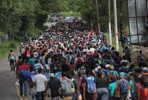 Some 1,500 Honduran immigrants walk north in a migrant caravan near Esquipulas, Guatemala.