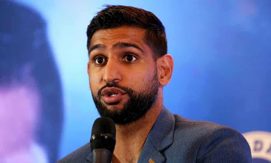"""Boxer Amir Khan has said he was escorted from an American Airlines flight in the US by police """"for no reason""""."""