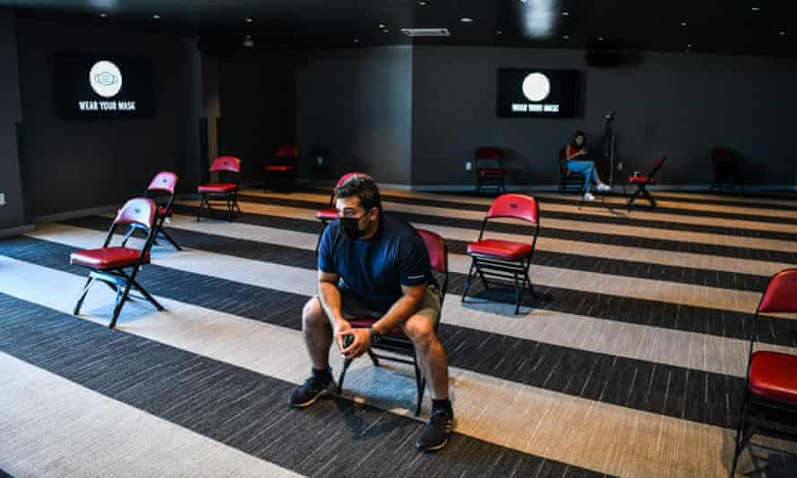 """FILES-US-HEALTH-VIRUS-VACCINE<br>(FILES) In this file photo taken on August 5, 2021 A man waits to get his Covid-19 vaccine during a vaccination event hosted by Miami Heat at FTX Arena in Miami. - With the United States recording its highest daily Covid case load in six months, a top public health official warned on August 8, 2021 that the country is """"failing."""" A surge in the highly transmissible Delta variant has brought a slew of bad news: total daily new cases have soared to 118,000, their highest since February; deaths are up 89 percent over the past two weeks, even while slightly declining around the world; and children's hospitals in US states like Florida are being overwhelmed as young people are increasingly affected. (Photo by CHANDAN KHANNA / AFP) (Photo by CHANDAN KHANNA/AFP via Getty Images)"""