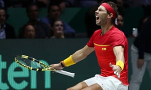 Rafael Nadal  shows his delight after beating Canada's Denis Shapovalov and winning the Davis Cup