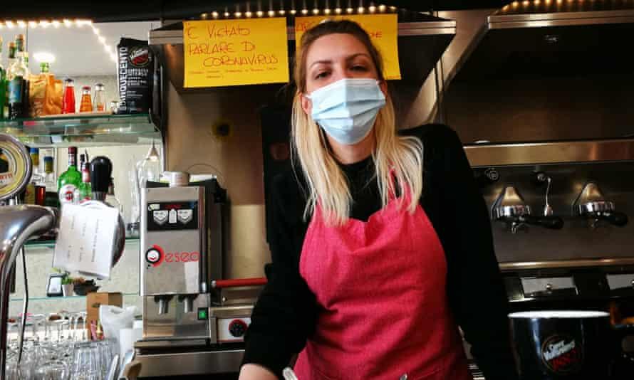 Cristina Mattioli, of Bar Feeling, with her notices banning virus talk.