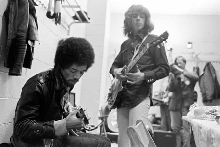 Down-to-earth star … Jimi Hendrix and Mick Taylor of the Stones backstage at Madison Square Garden in 1969.