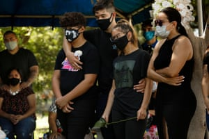 Family gather at the funeral of Fernando Aquirre who died of Covid-19 at the age of 69, on 20 July.