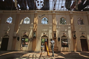 A surveyor assesses damage at St Sebastian's church, Negombo, where a suicide bomber blew himself up on Easter Sunday.