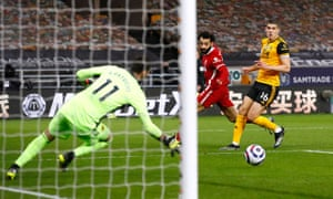 Mohamed Salah goes close for Liverpool.