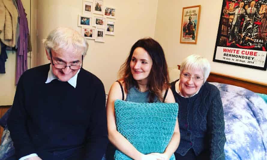 Sarah Marsh in her bedroom with her parents