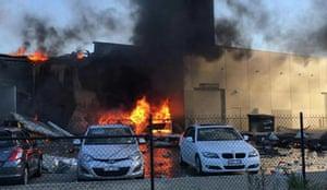 Melbourne, Australia A blaze rages after a charter plane crashed into a retail outlet, killing a pilot and four US tourists