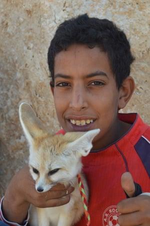 A Mos Espa souvenir seller with his tame desert fox.
