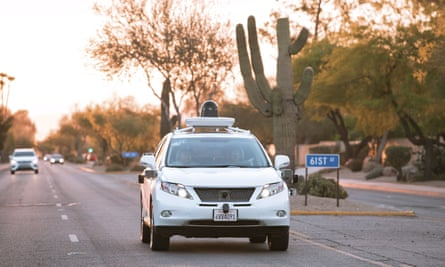 Test drivers use a Lexus SUV, built as a self-driving car, to map the area prior to a journey without a driver in control, in Phoenix, Arizona April 5, 2016.