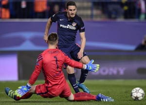 Atlético Madrid's Koke beats Barcelona's goalkeeper Marc-Andre Ter Stegen to the ball.