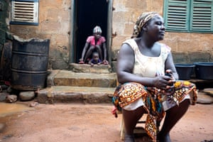 Janet Ahoro, 40, with her oldest daughter Stephanie, 23, and granddaughter Stephanie, 1, at her home in the fishing village of Fetteh