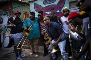 Trombonist Troy Andrews, centre, and members of the the Soul Rebels brass band pose with Cuban singer Cimafunk, third left