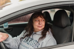 Kathleen Beatty sits in her car after picking up food from the Allentown Area Ecumenical food bank on Friday.