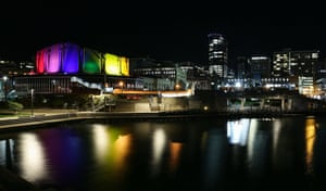 Wellington, New Zealand. The Michael Fowler Centre is lit up in the colours of the rainbow flag