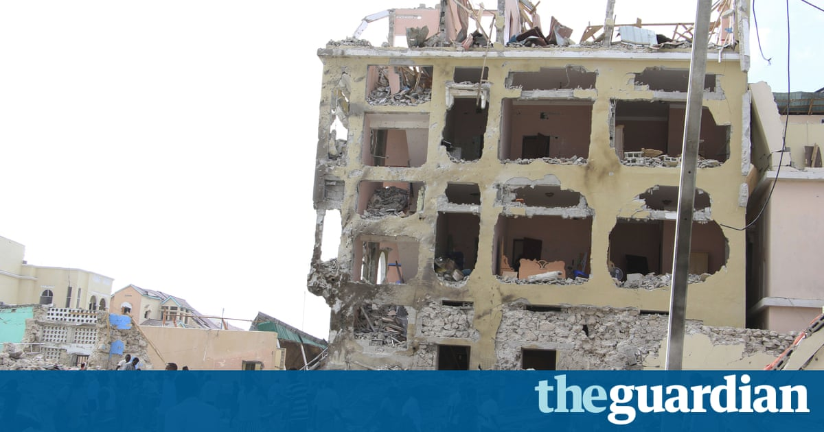 96d1f9be0c2 A second explosion is heard as news media gather to film the aftermath of a  suspected suicide car bomb attack on a hotel in Somalia s capital