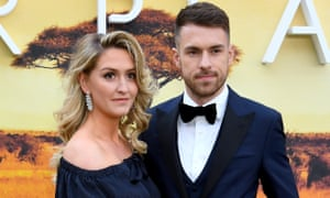 Aaron Ramsey, seen here attending the Our Planet premiere in London on Thursday night with his wife, Colleen Rowland, is set to return for Arsenal at the weekend.