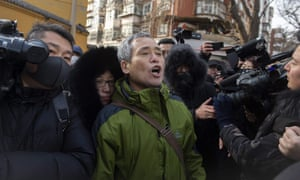 Yang Chunlin, a rights activist, shouts to show his support for detained Chinese human rights lawyer Wang Quanzhang outside the court in Tianjin before being arrested by plainclothes police.