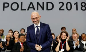 COP24 President Michal Kurtyka smiles after agreement is reached during the closing session in Poland