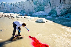 Scientist Ian Bartholomew uses dye tracing techniques as part of a study to measure the speed of the Russell Glacier near Kangerlussuag in Greenland