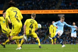 Oleksandr Zinchenko of Manchester City scores his team's fourth goal during the Carabao Cup Semi Final First Leg match between Manchester City and Burton Albion.
