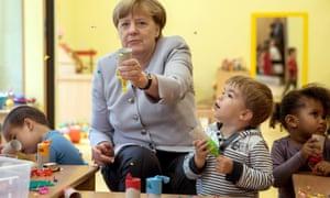 The German chancellor, Angela Merkel, visits a kindergarten in Berlin