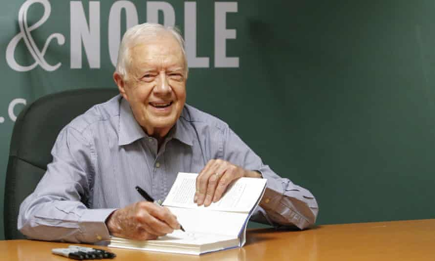 Former president Jimmy Carter signs his new book A Full Life: Reflections at Ninety in New York last month.