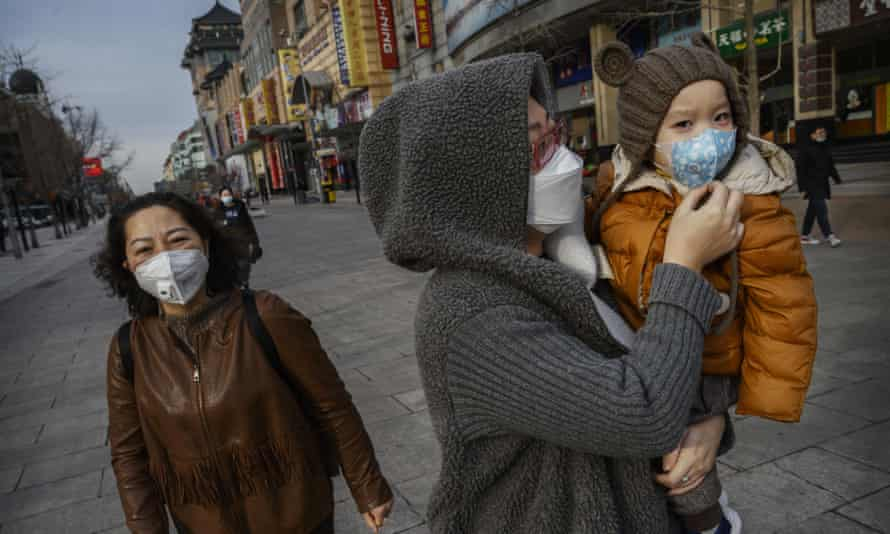 People wear masks in Beijing