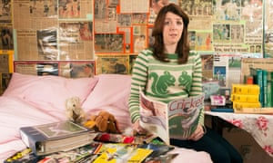 Emma John photographed at her home in north London with her cricket memorabilia.